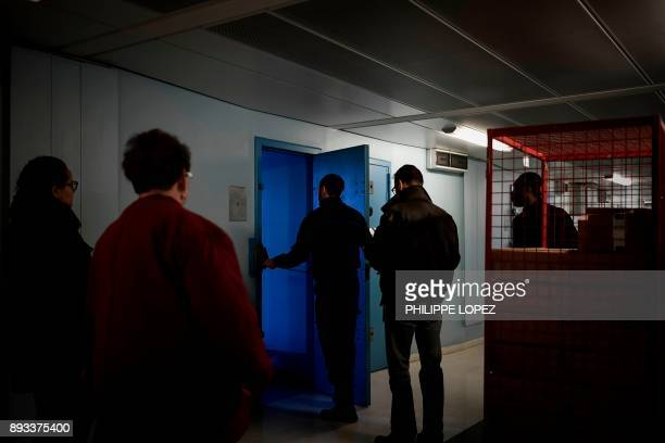 A prison chaplain takes part in a distribution of Christmas gifts by volunteers of the Christian charity organization 'Secours Catholique' on...