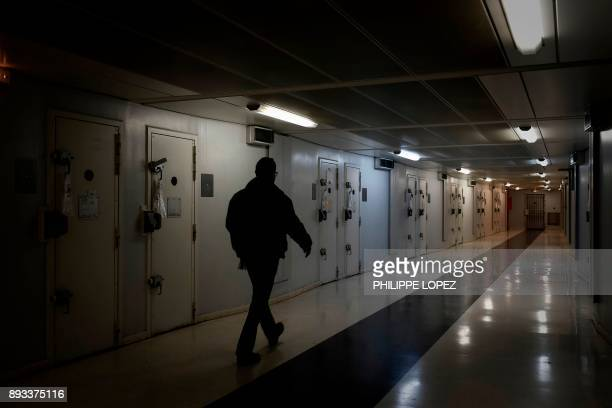 A prison chaplain walks in a corridor on December 14 2017 at the FleuryMerogis prison the largest prison in Europe located in the town of...