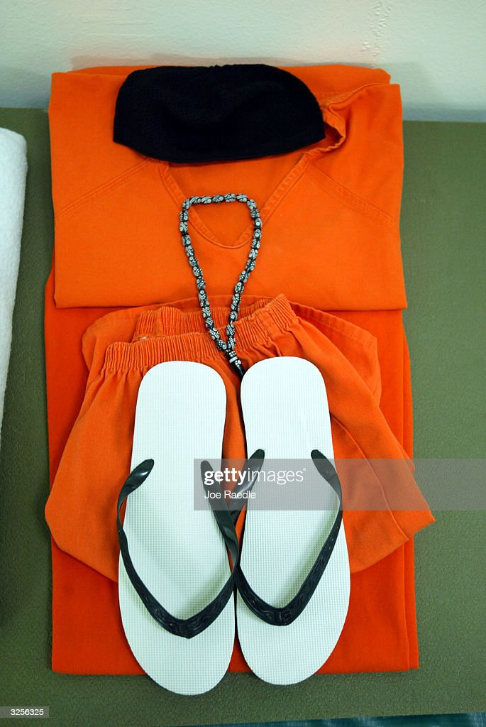 Prison garb which consists of, prayer beads, sandals, jump suit and skull cap lie on a bed in a cell at Camp Echo April 7, 2004 where detainees from the U.S. war in Afghanistan will meet their lawyers before going to a U.S. military tribunal in Guantanamo Bay, Cuba. On April 20, the U.S. Supreme Court is expected to consider whether the detainees can ask U.S. courts to review their cases. Approximately 600 prisoners from the U.S. war in Afghanistan remain in detention.