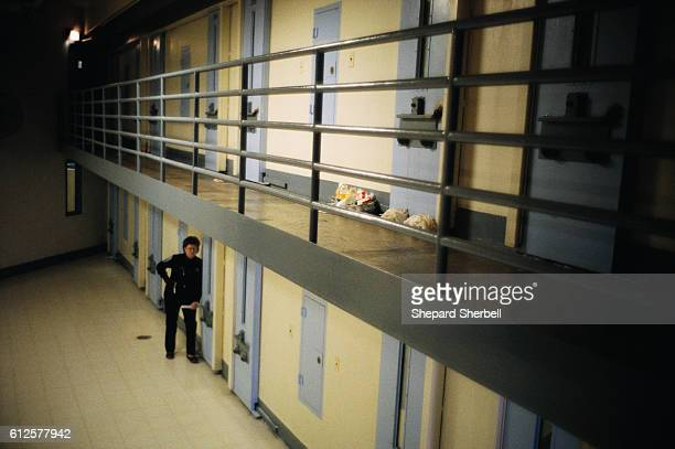 A prison guard checks the cell doors at Buckingham Correctional Institution | Location Dillwyn Virginia USA