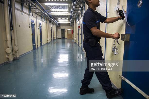 A prison guard closes a cell in the Parisian prison of 'La Santé' on July 25 in Paris The last 60 prisonners of La Sante were transferred on July 20...