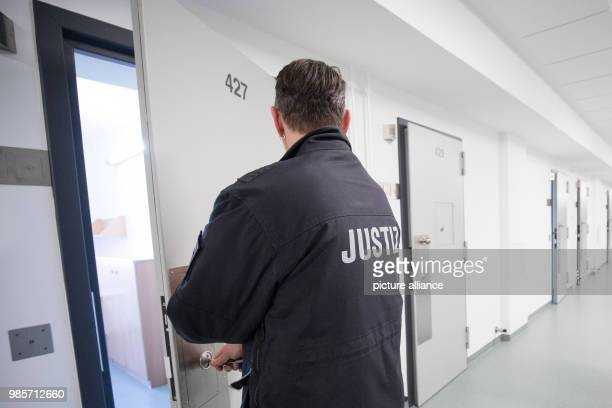 A prison guard locking a cell's door in the recently renovated Bwing of the Holstenglacis remand centre during a tour for the press in Hamburg...