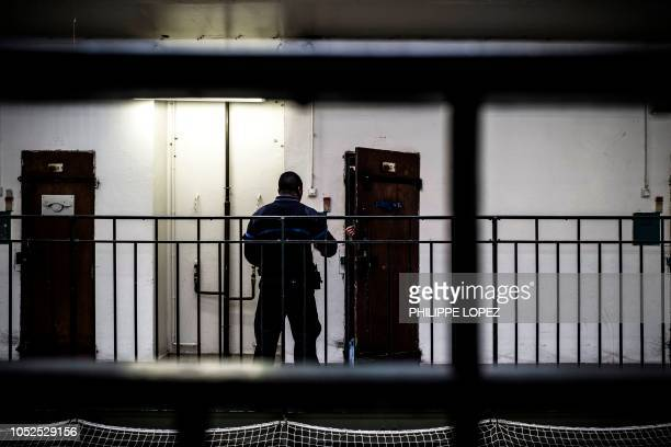A prison guard opens a cell at Fresnes Prison in Fresnes near Paris on October 17 2018