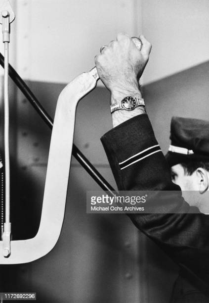 A prison guard prepares to pull the lever which mixes a pellet of cyanide with acid releasing lethal fumes into the gas chamber at San Quentin's...