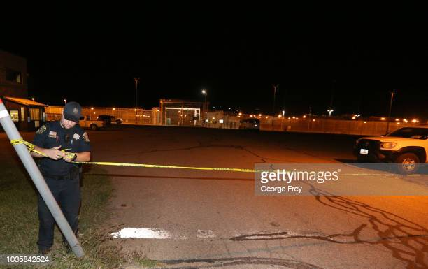 A prison guard puts up yellow police tape outside an entrance to the Utah Sate Prison woman facility on September 19 2018 in Draper Utah Wanda Barzee...