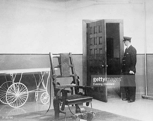 A prison guard stood in the Electric Chair room at Sing Sing Prison New York
