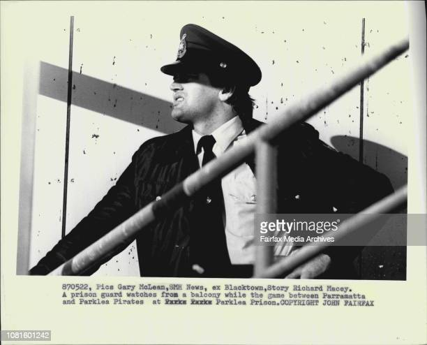 A prison guard watches from a balcony while the game between Parramatta and Parklea Prates at Parklea Prison May 22 1987