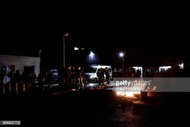 Prison guards block access to the Nanterre prison on January 18 2018 in Nanterre to demand tighter security after three officers were injured in an...