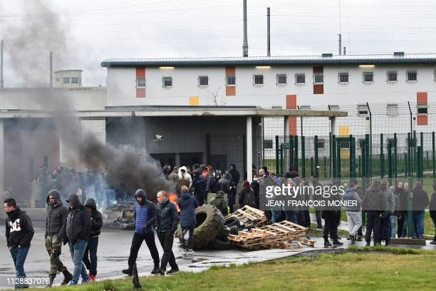 Prison guards block the entrance to the penitentiary center of Alencon, in Conde-sur-Sarthe, northwestern France, on March 6 a day after a prison...