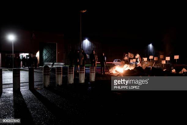 Prison guards burn wooden palettes as they block access to the Nanterre prison on January 18 2018 in Nanterre to demand tighter security after three...