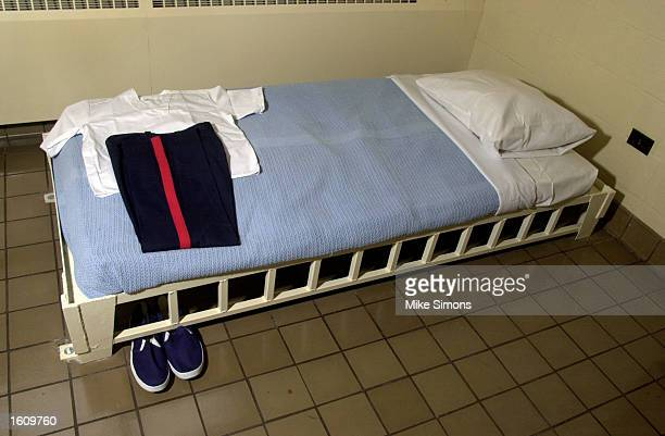 Prison inmate clothes lie on a bed in the holding cell of the Southern Ohio Correctional Facility August 29 2001 in Lucasville Ohio