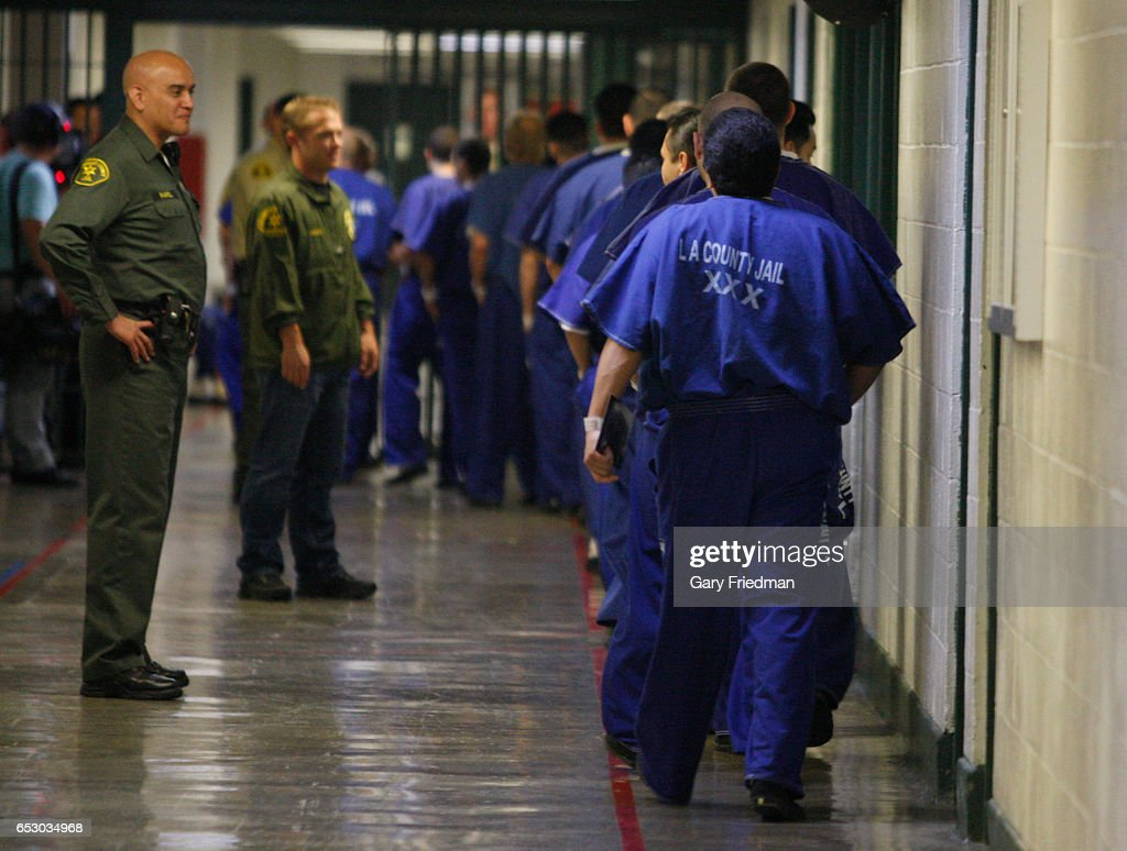 Prison inmates are watched by members of the Los Angeles County Sheriff's Dept. at the Men's Central Jail in Los Angeles on August 29, 2012.