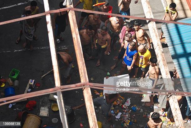Prison inmates throw debris outside their jail cells after a protest broke out in a Quezon City jail on February 23 2012 in Quezon City Philippines...