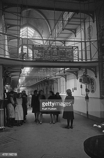 A prison officer and a group of inmates at Holloway Prison's 'Centre' where the various wings of the jail meet and where prisoners' outofcell...