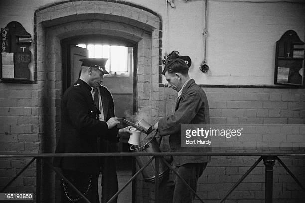 Prison officer Davidson serving a prisoner a meal at Strangeways Prison in Manchester November 1948 Original publication Picture Post 4682 The Life...