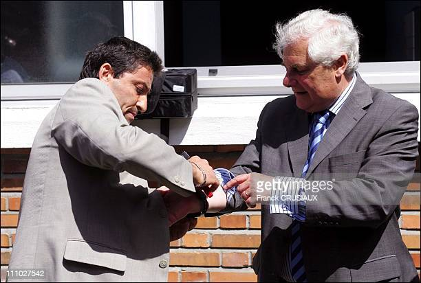 A prison officer give a electronic bracelet around the wrist Pascal Clement keeper of the Seals Minister of Justice in Haubourdin France on August...