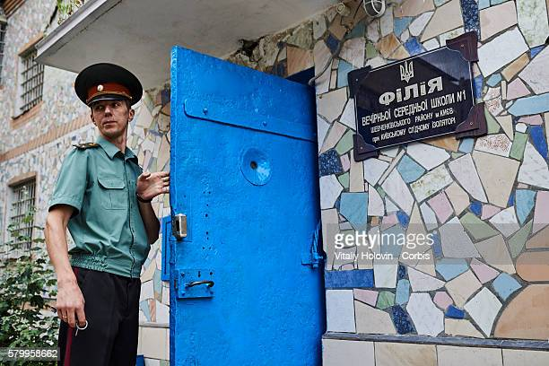 A prison officer stands outside an educational area during a Ukrainian Ministry of Justice organised media press tour on June 19 2016 in Kiev Ukraine...
