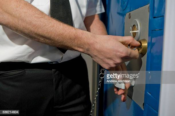 A prison officer unlocks a cell door during a training exercise HMP Wandsworth London United Kingdom