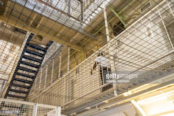 A Prison Officer walks along the landing of Her Majestys Prison Pentonville London United Kingdom Pentonville is a local prison and holds Category B...
