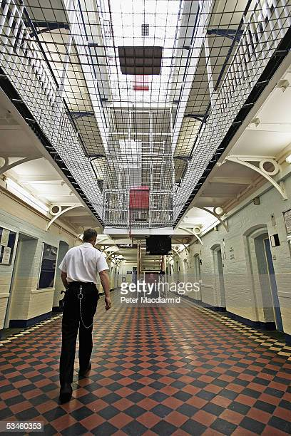 A prison officer walks through A Wing of Norwich Prison on August 25 2005 in Norwich England A Chief Inspector of Prisons report on Norwich Prison...