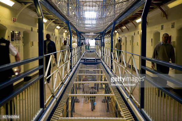 Prison officers and prisoners walk down the corridor of the A wing at Wandsworth prison The main prison has 5 wings each with 4 landings A wing holds...