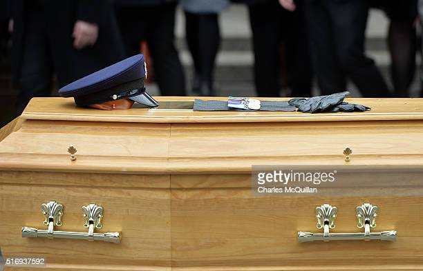A prison officers cap medals and gloves can be seen as the funeral of murdered prison officer Adrian Ismay takes place on March 22 2016 in Belfast...