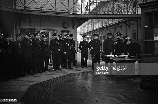 Prison officers line up before being dismissed for the day at Strangeways Prison in Manchester November 1948 Original publication Picture Post 4682...