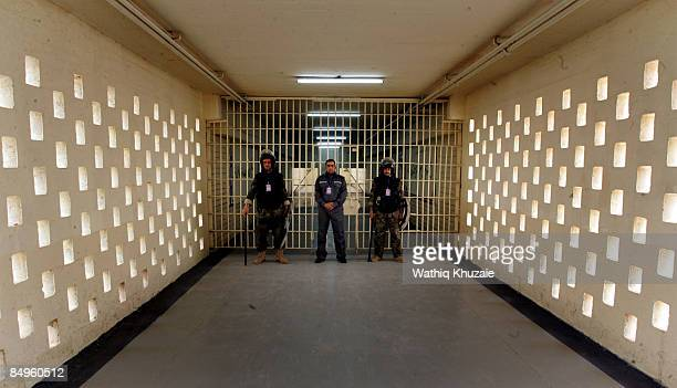 Prison security personnel stand guard at the newly opened Baghdad Central Prison in Abu Ghraib on February 21 2009 in Baghdad Iraq The Iraqi Ministry...