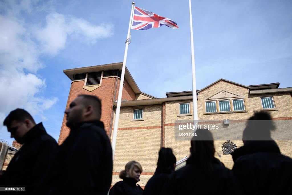 Prison staff and supporters gather outside HM Prison Bedford during an unofficial protest on September 14, 2018 in Bedford, England. The Prison Officers Association called for staff to stage an immediate walk-out this morning demanding the government improve safety in jails and reduce overcrowding and violence among inmates.