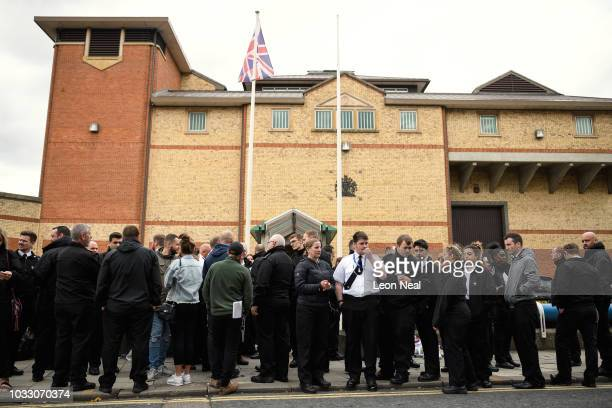 Prison staff and supporters gather outside HM Prison Bedford during an unofficial protest on September 14 2018 in Bedford England The Prison Officers...