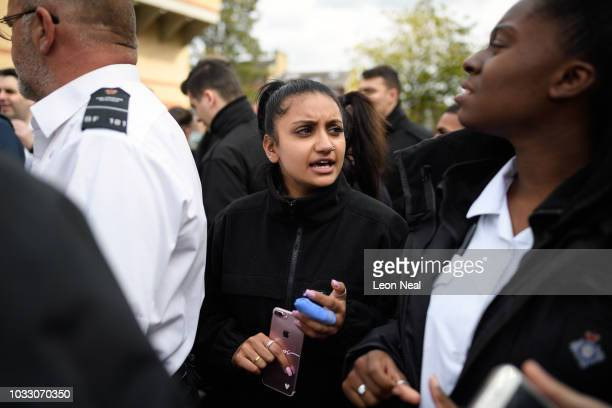 Prison staff and supporters listen as they are told to return to work at 1pm outside HM Prison Bedford at the end of an unofficial protest on...