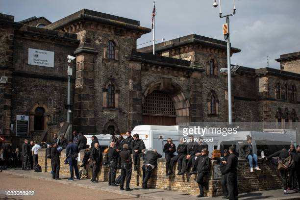 Prison staff at HMP Wandsworth gather outside after staging a 'walkout' on September 14 2018 in London England The Prison Officers Association called...