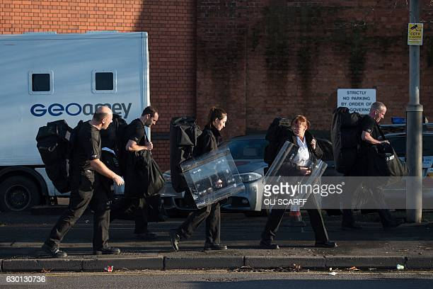 Prison staff carrying riot shields leave HMP Birmingham in Winson Green Birmingham central England on December 17 2016 British riot police late...