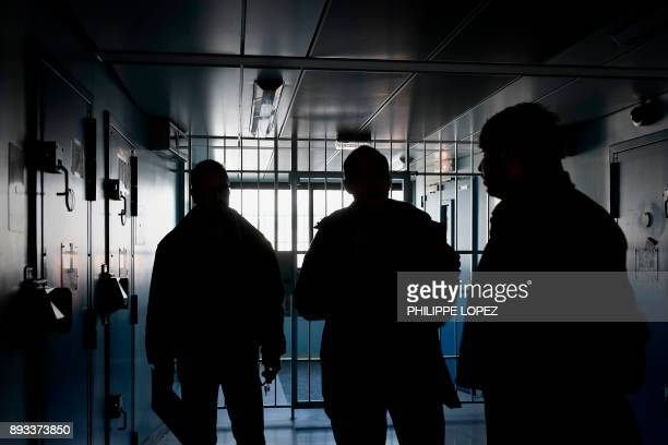 Prison supervisors walk in a corridor on December 14 2017 at the FleuryMerogis prison the largest prison in Europe located in the town of...