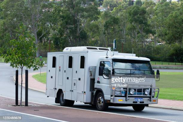 A prison van believed to be transporting former West Coast Eagles AFL player Ben Cousins leaves the Armadale Magistrates Court in Perth on Thursday...