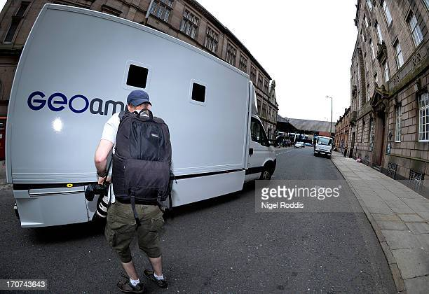 A prison van leaves carrying Broadcaster Stuart Hall after he was sentenced to 15 months in prison at Preston Crown Court on June 17 2013 in Preston...