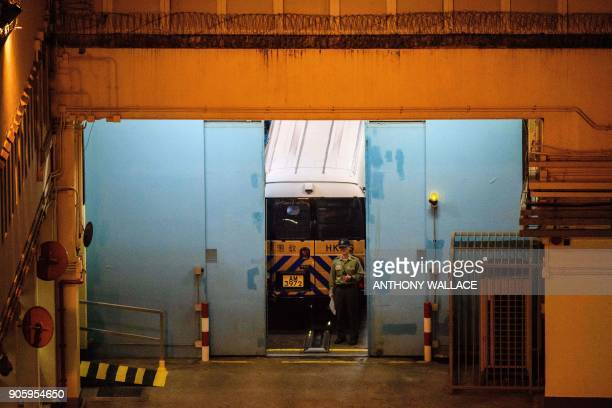 A prison van parks at Lai Chi Kok Reception Centre after bringing prodemocracy activists Joshua Wong and Raphael Wong following their jailing on...