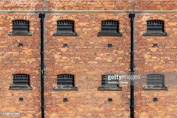prison walls - andrew dernie stock pictures, royalty-free photos & images
