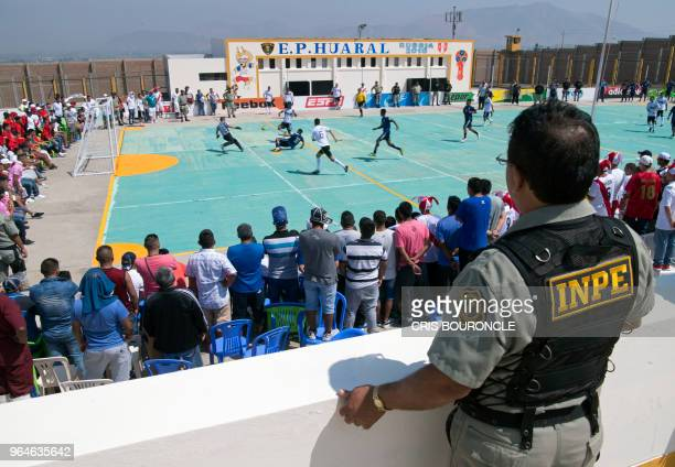 TOPSHOT A prison warden stand guard as inmates from Peruvian jails take part in the First Interprison World Cup Russia 2018 tournament at the prison...