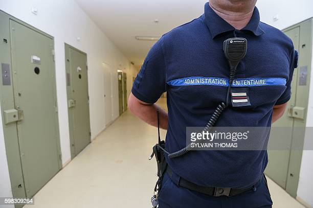 A prison warder is pictured on r on September 1 2016 in the prison of Beziers southern France / AFP / SYLVAIN THOMAS