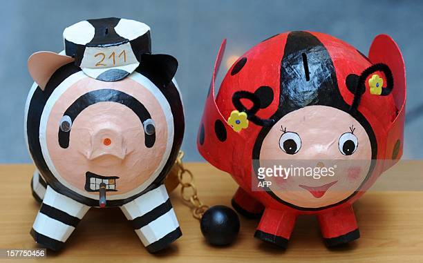 A prisoner and a ladybug piggy bank are pictured in the socalled Gitterladen in the Justice Ministry in Dresden eastern Germany on December 5 2012 In...