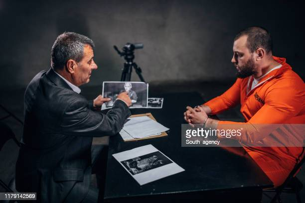 prisoner and detective - prosecutor stock pictures, royalty-free photos & images
