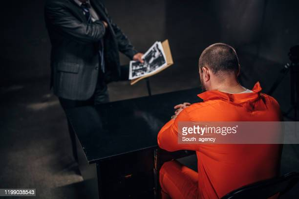 prisoner and detective - confession law stock pictures, royalty-free photos & images