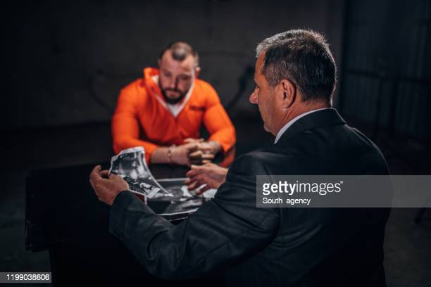prisoner and detective - criminal stock pictures, royalty-free photos & images