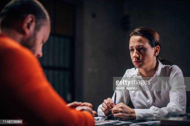 prisoner and female detective - criminal stock pictures, royalty-free photos & images