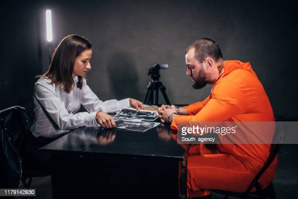prisoner and female detective - prosecutor stock pictures, royalty-free photos & images
