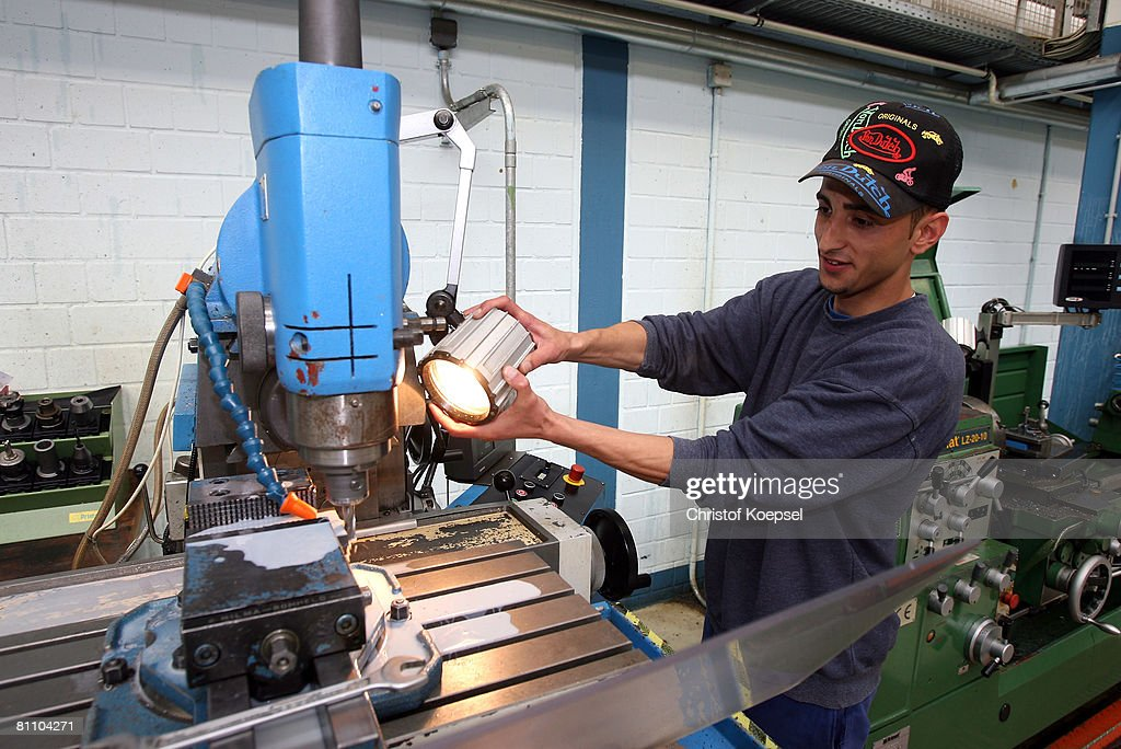Prisoner Ati fworks to be a professional machinist at the Iserlohn prison on May 15, 2008 in Iserlohn, Germany. The prison in North Rhine-Westphalia inhabits 292 sentenced young men between 14 and 24 years and offers school education and different technical professions.
