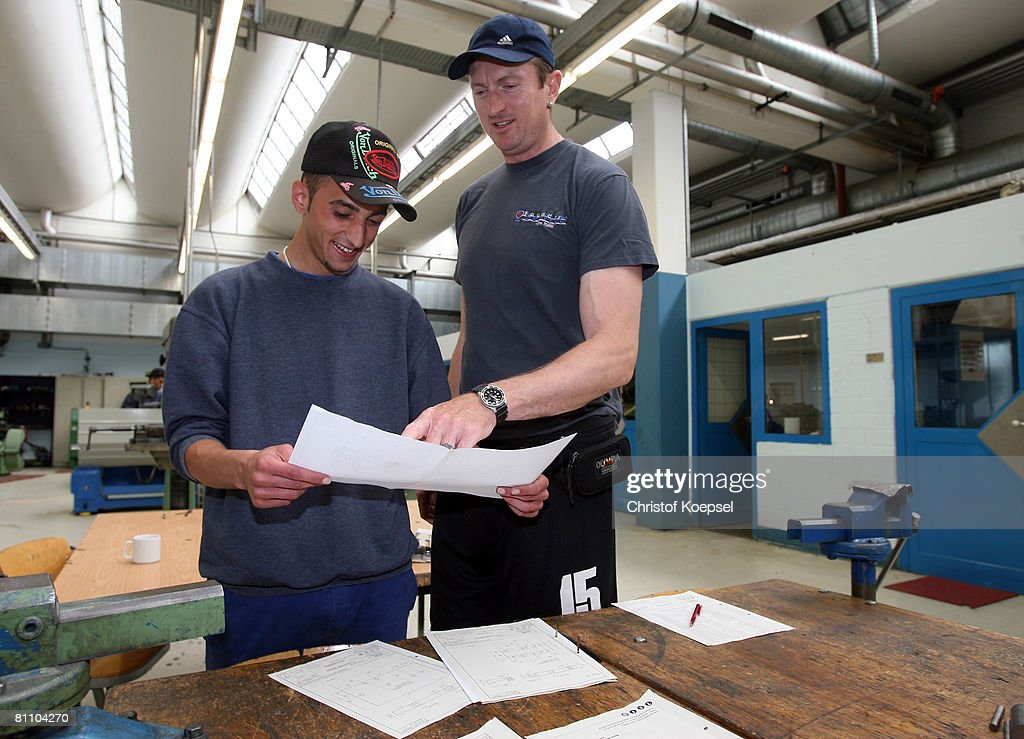 Prisoner Atif (L) and justice officer Ingo Siebert (R) watch a script of metal tools at the Iserlohn prison on May 15, 2008 in Iserlohn, Germany. The prison in North Rhine-Westphalia inhabits 292 sentenced young men between 14 and 24 years and offers school education and different technical professions.