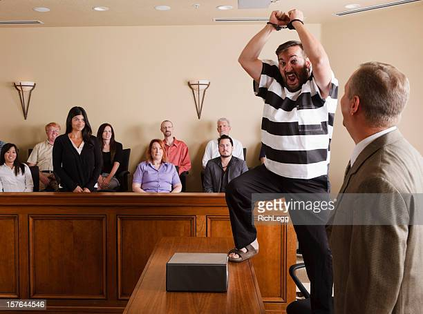 prisoner celebrating in court - juror law stock pictures, royalty-free photos & images