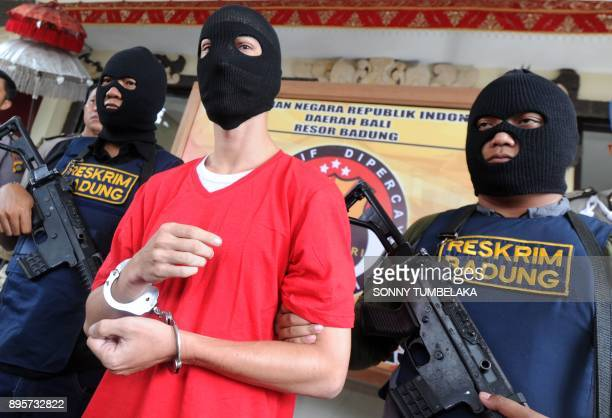 US prisoner Christian Beasley holds by Indonesia police during a press conference at a police station in Badung regency on Indonesia's resort island...